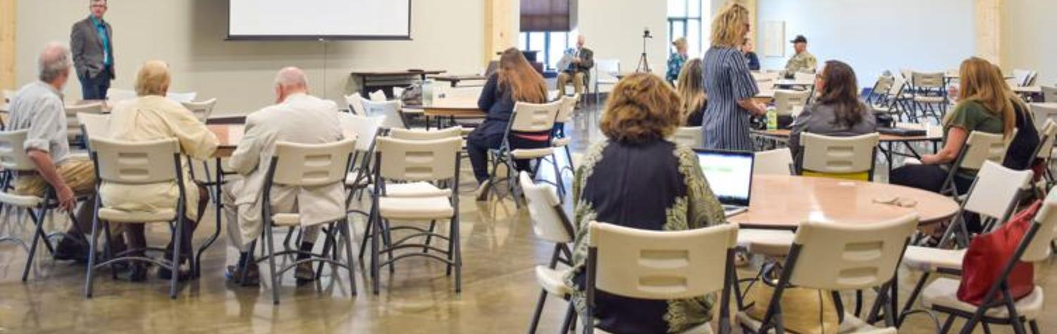 Attendees mingle before the STAT community presentation at the Montrose County Event Center on Thursday. (Emily Ayers, Montrose Daily Press)