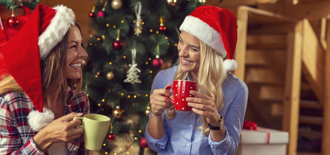 Girls drinking coffee at Christmas