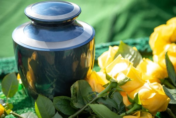 Funeral urn with yellow roses