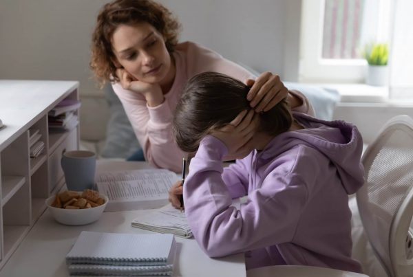Loving mother supporting tired teenage daughter (photo)