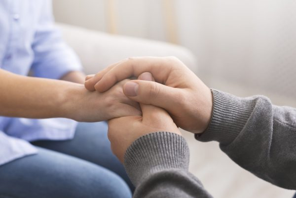 Hold hands and consoling